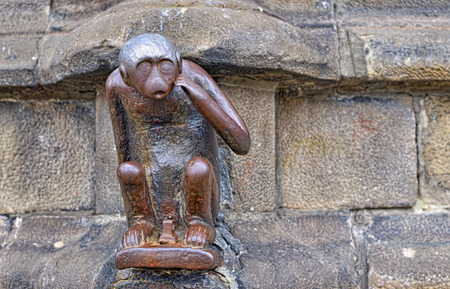 medieval blacksmith: A several centuries old statue of monkey on Grand Place of Mons, Belgium, which brings good luck to those who touch its head