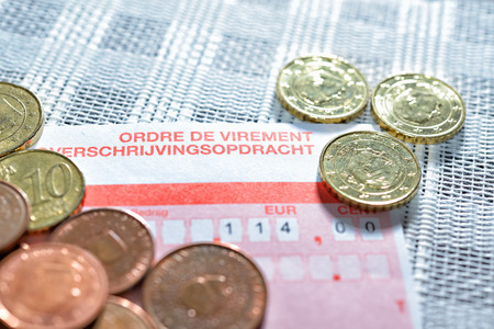 Payment order form with amount and euro coins closeup image photo