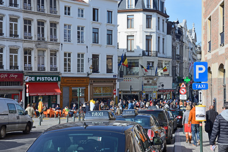 BRUSSELS, BELGIUM-MARCH 08, 2014: Rue de la Madeleine is crowded by tourists on first warm spring days. In 2012 amount of visitors per year for Brussels exceeded 6 million