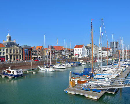 ARSENAAL, NETHERLANDS-MARCH 16, 2014: Marina in historical center of the city with sailing boats prepared for the new season.  Stock Photo - 27964921