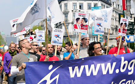 defile: BRUSSELS, BELGIUM-MAY 15, 2010: Activists of Gay Pride Parade participate in annual defile