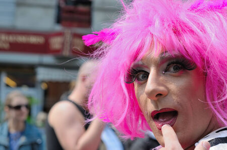defile: BRUSSELS, BELGIUM-MAY 15, 2010: Activist of Gay Pride Parade participates in annual defile