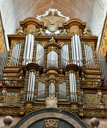 walloon: SAINT-HUBERT, BELGIUM-MAY 31, 2014: Organ in Basilica Saint Hubert. This basilica is a main architectural attraction of the city and has first buildings built in 7 century. Editorial