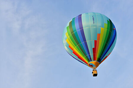 walloon: ROCHEFORT, BELGIUM-MAY 31, 2014: Hot air balloons in the sky of Walloon. Expensive sport is supported by different sponsors which place their logos on the balloons. Editorial