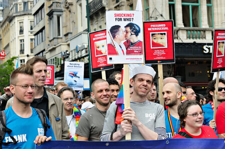 defile: BRUSSELS, BELGIUM-MAY 15, 2010: Activists of Gay Pride Parade participate in annual defile. Editorial