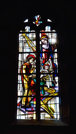STEENKERQUE, BELGIUM-JUNE 30, 2014: Stained glass window in Saint Martin Church in Steenkerque, commune Braine-le-Comte, created in 1963. The church is known from 16 century. Editorial