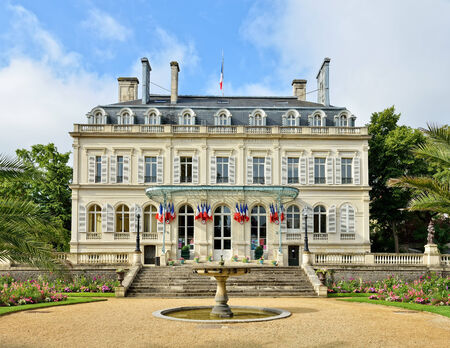 georgina: EPERNAY, FRANCE-JULY 14, 2014: City hall in historical center of town. The garden and the building were created in the middle of 19 century