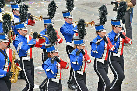 defile: HALLE, BELGIUM-MARCH 30, 2014: Fanfares orchestra participate in defile on Grand Place of Halle during yearly Halle Carnival. Editorial