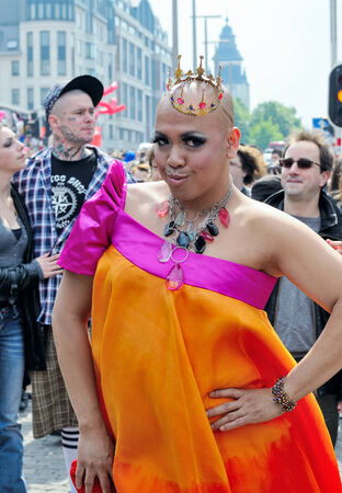 homophobia: BRUSSELS, BELGIUM-MAY 15, 2010: Participant of Gay Pride Parade shows his creative costume Editorial