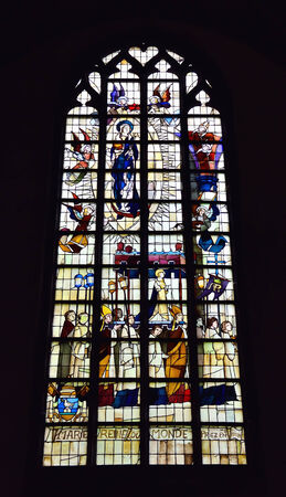 BRAINE-LE-COMTE, BELGIUM-JUNE 30, 2014: Stained glass window in church of Saint Gery.
