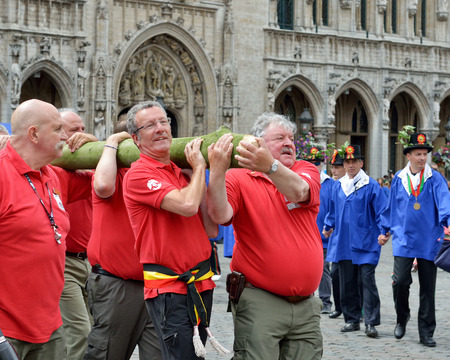 participate: BRUSSELS, BELGIUM-AUGUST 09, 2014: The mayor of Brussels Yvan Mayeur and the former mayor Freddy Thielemans participate in Plantation of Meyboom ceremony on Grand Place. The first ceremony had place in the same day in 1308. Editorial