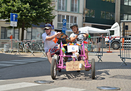 HALLE, BELGIUM-AUGUST 03, 2014: Unidentified participants in fifth Gocarts race in historical center of city