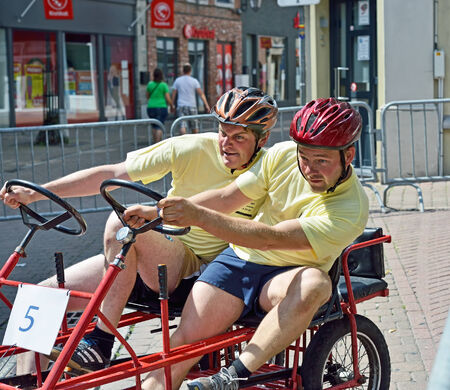 HALLE, BELGIUM-AUGUST 03, 2014: Unidentified participants in fifth Gocarts race in historical center of city.