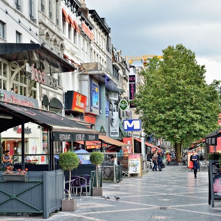 louise: BRUSSELS, BELGIUM-AUGUST 20, 2014: Avenue de Toison dOr. This is a famous shopping street and promenade area in Brussels Editorial