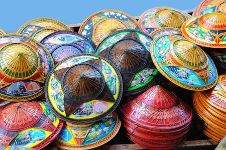 BANGKOK, THAILAND-DECEMBER 25, 2009: Traditional national hats with complex decor sold on the local market.
