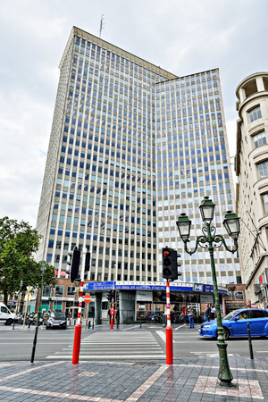 louise: BRUSSELS, BELGIUM-AUGUST 20, 2014: Servcorp Bastion Tower and metro station port Namur. This is famous business and shopping area of the city