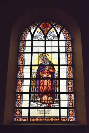MIGNAULT, BELGIUM-AUGUST 22, 2014: Stained glass window in Saint-Martin Church Editorial