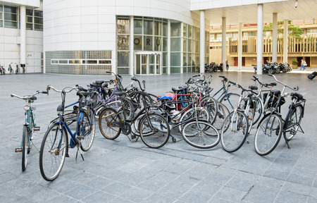HAGUE, NETHERLANDS-AUGUST 01, 2014: Old bicycles decorate a small square close to the Forum and local administration buildings.