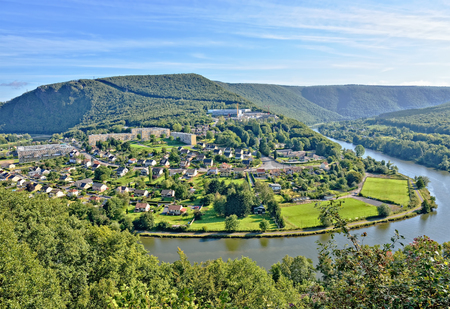 meuse: Panorama of Revin, a small town on river Meuse in Champagne-Ardenne, France under morning sun