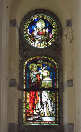 wallonie: VISE, BELGIUM-JULY 07, 2014: Complex stained glass window in Collegiale Saint-Martin and Saint-Hadelin or church of Saint-Martin of Vise. The history of the church starts from 1338