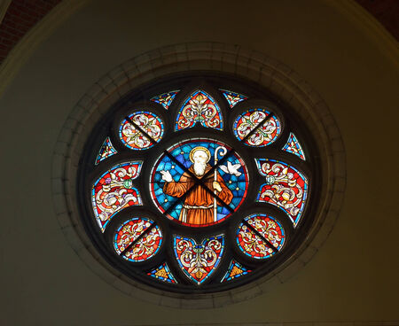 VISE, BELGIUM-JULY 07, 2014: Rose window or Catherine window of Collegiale Saint-Martin and Saint-Hadelin or church of Saint-Martin of Vise. The history of the church starts from 1338