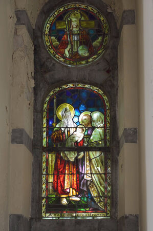vise: VISE, BELGIUM-JULY 07, 2014: Complex stained glass window in Collegiale Saint-Martin and Saint-Hadelin or church of Saint-Martin of Vise. The history of the church starts from 1338