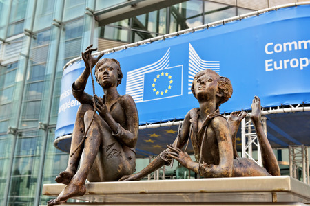 BRUSSELS, BELGIUM-SEPTEMBER 16, 2014: Modern office of European Commission institution decorated with a sculpture group