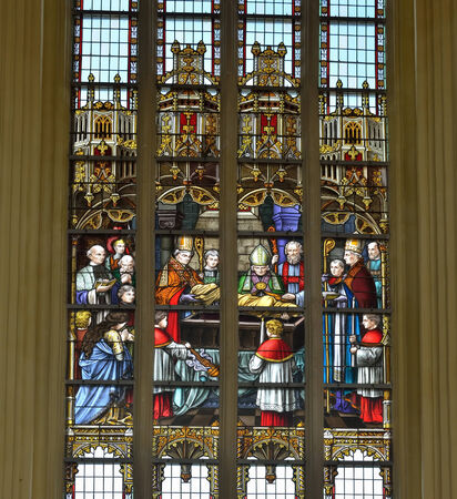 walloon: VISE, BELGIUM-JULY 07, 2014: Complex stained glass window in Collegiale Saint-Martin and Saint-Hadelin or church of Saint-Martin of Vise. The history of the church starts from 1338