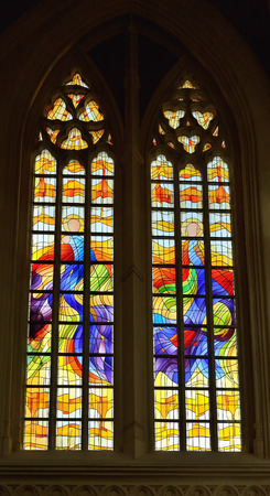 wallonie: VISE, BELGIUM-JULY 07, 2014: Abstract style stained glass window in Collegiale Saint-Martin and Saint-Hadelin or church of Saint-Martin of Vise. The history of the church starts from 1338