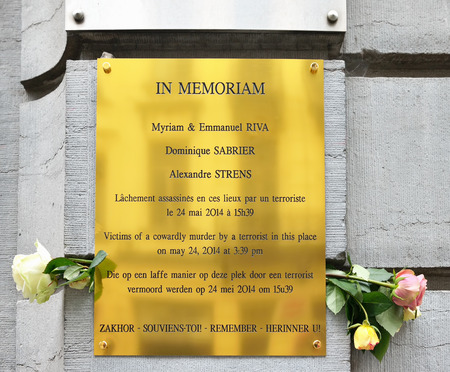 24 26: BRUSSELS, BELGIUM-SEPTEMBER 26, 2014: Memorial plaque on the wall of The Jewish Museum of Belgium installed to commemorate victims of the May 24, 2014 shooting Editorial