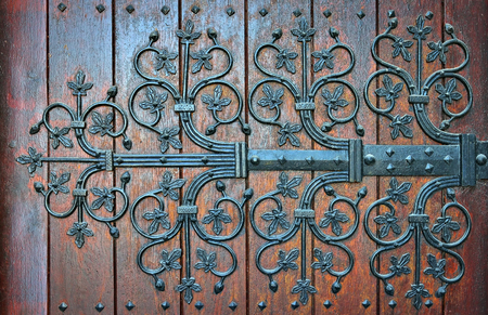 Medieval style wooden gates of basilica Saint-Materne or Notre-Dame de Walcourt in Walcourt, Belgium