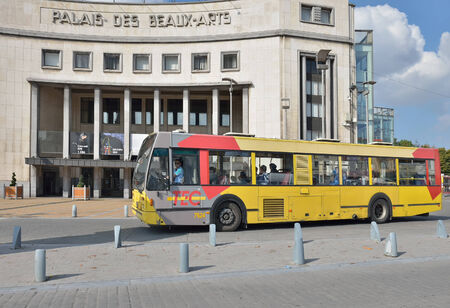 wallonie: CHARLEROI, BELGIUM-OCTOBER 04, 2014: Bus arrives to Palais des Beaux-Arts in center of the city. The city and its region are the ones from mostly affected by the crisis parts of the country
