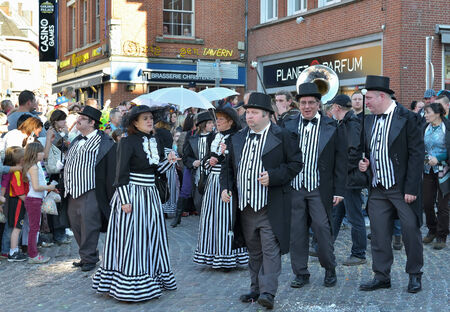defile: NIVELLES, BELGIUM-MARCH 09, 2014: Unidentified participants in creative costumes join defile during annual carnival