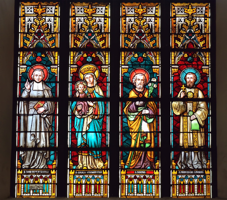 MONS, BELGIUM-OCTOBER 10, 2014: Stained glass window in Saint Elisabeth. The history of the church on this place started in 1516