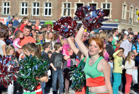 defile: NIVELLES, BELGIUM-MARCH 09, 2014: Unidentified participants as cheerleaders in defile during yearly carnival