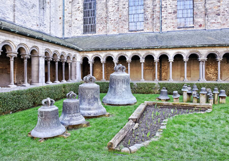 walloon: NIVELLES, BELGIUM-MARCH 09, 2014: Collection of church bells in Collegiate Church of Saint Gertrude. Consecration of the church was in 1046