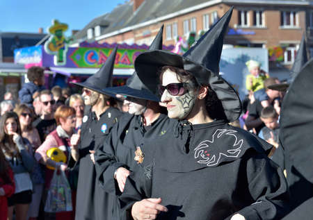 defile: NIVELLES, BELGIUM-MARCH 09, 2014: Unidentified group representing witches in black costumes in defile during yearly carnival Editorial