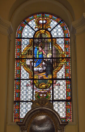 liege: LIEGE, BELGIUM-OCTOBER 19, 2014: Stained glass window in Collegiate church of Saint-Denis of Liege. The church was founded in 10 century and organ was built in 1589 Editorial