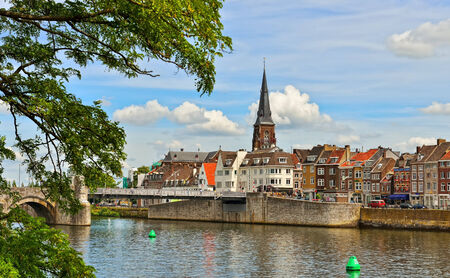 maas: MAASTRICHT, NETHERLANDS-JULY 07, 2014: Panorama of Maastricht from river Maas or Meuse. The city is a capital of Limburg province and one of popular tourist destinations Editorial