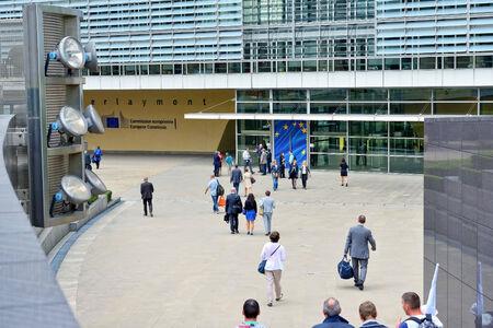 headquarter: BRUSSELS, BELGIUM-SEPTEMBER 18, 2014: People entering modern building of the European Commission headquarter in Brussels