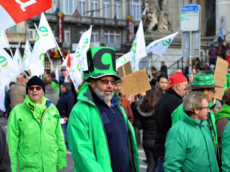 walloon: BRUSSELS, BELGIUM-OCTOBER 06, 2014: National manifestation against austerity measures introduced by Belgian government. More than 100000 participants expected on streets of Brussels Editorial