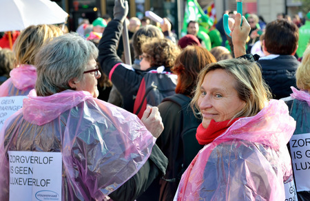 austerity: BRUSSELS, BELGIUM-NOVEMBER 06, 2014: National manifestation against austerity measures introduced by Belgian government. More than 100000 participants expected on streets of Brussels Editorial