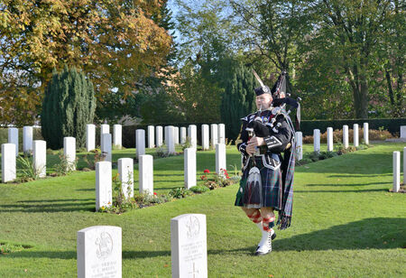 first australians: YPRES, BELGIUM-NOVEMBER 11, 2014: Commemoration ceremony at Ramparts cemetery on Armistice Day. 198 graves of soldiers of First World War 1914-1918