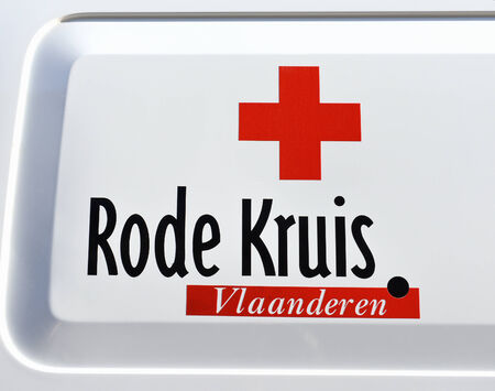 ypres: YPRES, BELGIUM-NOVEMBER 11, 2014: Red Cross of Flanders car on service during celebration of Armistice Day Editorial