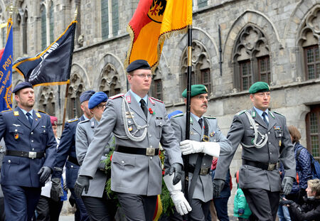 ypres: YPRES, BELGIUM-NOVEMBER 11, 2014: Participants of Poppy Parade commemorating 100 years of World War I march from Grand Place to Porte de Menin or Gates of Menin