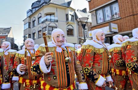 NIVELLES, BELGIUM-MARCH 09, 2014: Gilles De Binche in traditional masks during carnival defile in Nivelles.