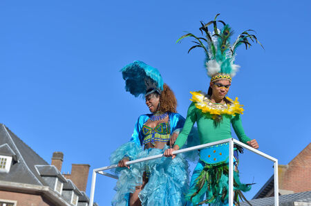 defile: NIVELLES, BELGIUM-MARCH 03, 2014: Unidentified happy participants of parade in defile during yearly carnival in Nivelles