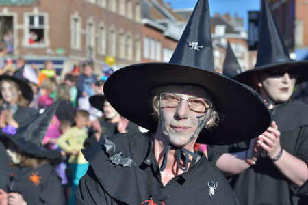 defile: NIVELLES, BELGIUM-MARCH 03, 2014: Group in costumes of witches participates in defile during yearly carnival in Nivelles Editorial
