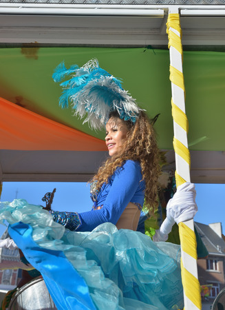 walloon: NIVELLES, BELGIUM-MARCH 03, 2014: Unidentified happy participant of parade in defile during yearly carnival in Nivelles