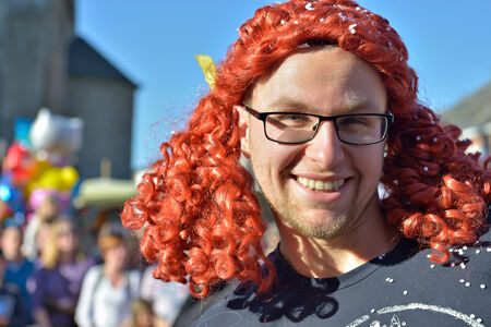 defile: NIVELLES, BELGIUM-MARCH 03, 2014: Unidentified happy participant of parade in defile during yearly carnival in Nivelles